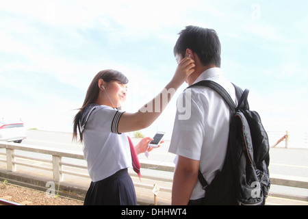Young people listening to music on smartphones - Stock Photo