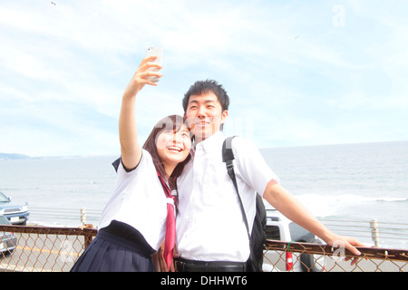Young couple taking self portrait photograph - Stock Photo