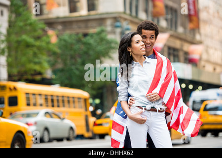 Couple with American flag - Stock Photo