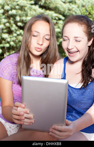 Friends using digital tablet Stock Photo