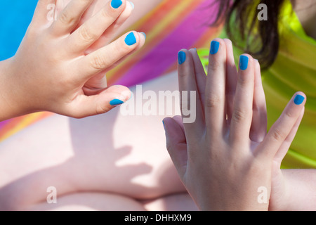 Friends touching hands - Stock Photo