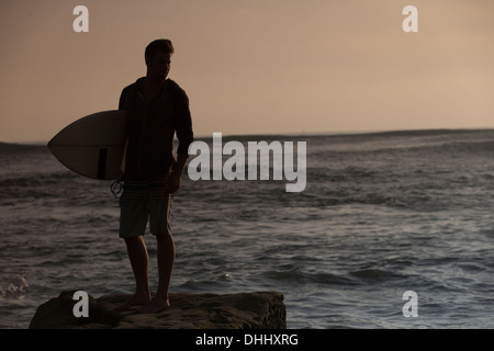 Silhouette of young male surfer, San Diego, California, USA
