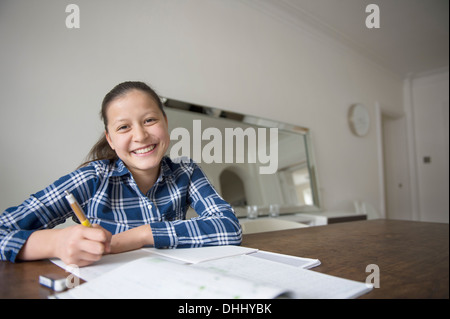 Teenage girl doing homework - Stock Photo