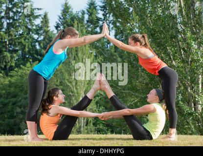 Teenage girls doing yoga - Stock Photo
