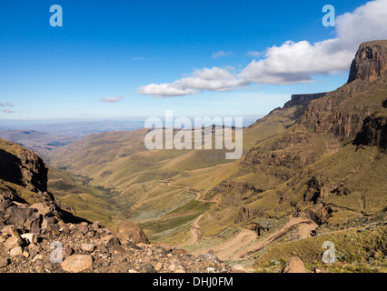 Valley and the winding road over mountains from South Africa to Lesotho over Sani Pass - Stock Photo