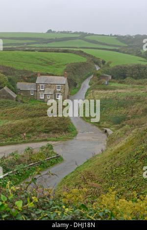 Isolated cottage on the Cornish coast near Boswinger, Cornwall, England, UK - Stock Photo