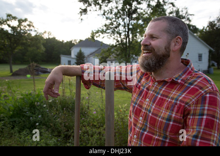 Portrait of mature man on herb farm - Stock Photo