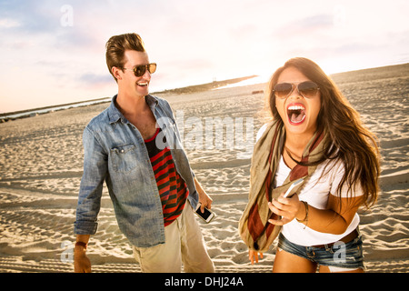 Young couple laughing on Mission Beach, San Diego, California, USA - Stock Photo