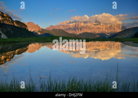Sella range reflecting in a mountain lake, Val Gardena, Dolomites, UNESCO world heritage site Dolomites, South Tyrol, - Stock Photo