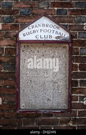 Empty notice board on brick wall - Stock Photo