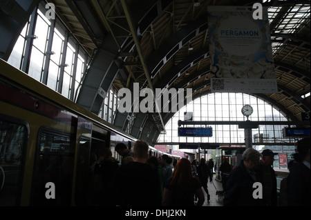People leaving and entering an S-Bahn train at Platform 4, Alexanderplatz Railway Station (Bahnhof Alexanderplatz), - Stock Photo