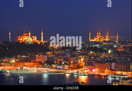 ISTANBUL, TURKEY. A nighttime view of Eminonu and Sultanahmet, the Golden Horn, Aya Sofia (left) and the Blue Mosque - Stock Photo