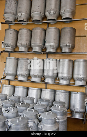 Milk Cans in a cheese dairy, Les Hauderes, Valais, Switzerland - Stock Photo