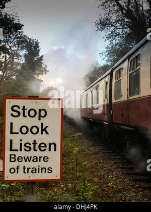 Safety sign on an old steam railway line crossing. Staverton. Devon - Stock Photo