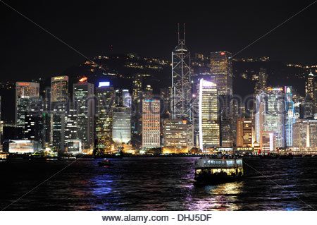 Victoria Harbour and skyline in the night, skyscrapers at Chung Wan, Central District, Hong Kong Island, Hongkong, - Stock Photo