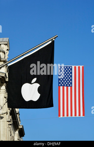 Flagpole with Apple logo flag & stars and stripes American Flag above Apple store entrance suspended across Regent - Stock Photo