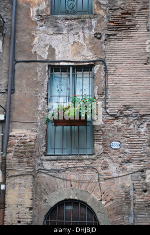 Crumbling balcony in Via Portico d'Ottavia, Jewish ghetto district in Rome, Italy - Stock Photo