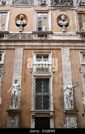 Wall sculptures in the atrium of the Italian Centre for American Studies - Centro Italiano Studio Americani, Rome - Stock Photo