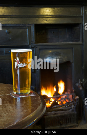 A pint of Robinson's Dizzy Blonde pale beer, in a pub with an open fire - Stock Photo