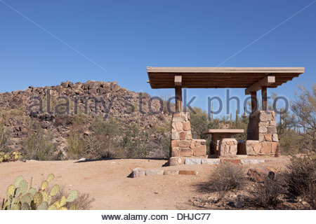 Signal Hill from Signal Hill Picnic Area Saguaro National Park Tucson Mountain District West ramadah in foreground - Stock Photo