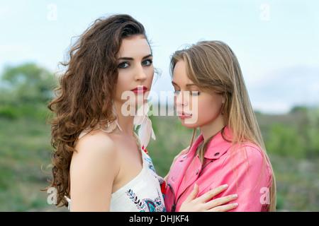 Two upset women - Stock Photo