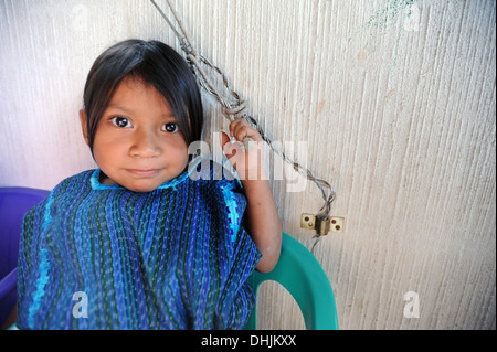 Guatemala indigenous girl in traditional clothing in San Antonio Palopo, Solola, Guatemala. - Stock Photo