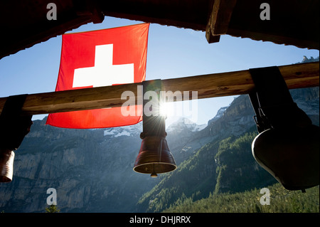 Swiss flag and cow bells at lake Oeschinensee, Kandersteg, Bernese Oberland, Canton of Bern, Switzerland, Europe - Stock Photo