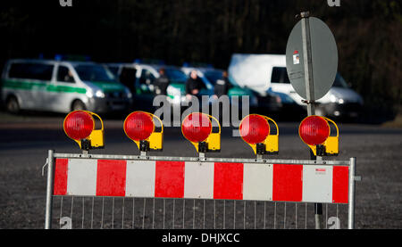 Karsdorf, Germany. 12th Nov, 2013. Policemen block a road because of the defusing of several aerial bombs from WWII - Stock Photo