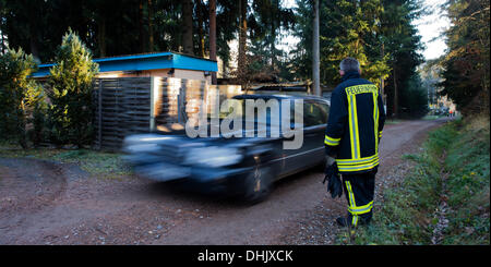Karsdorf, Germany. 12th Nov, 2013. Residents of a camping site have to leave before the defusing of several aerial - Stock Photo