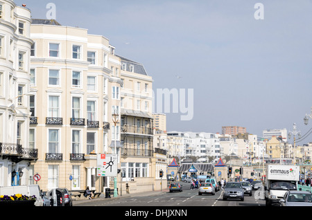 Light coloured Victorian-era hotels on the sea front; typical English seaside resort scene.