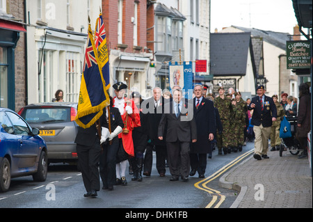 Remembrance Sunday parade with British Legion flags in front at Hay-on-Wye Powys Wales UK - Stock Photo