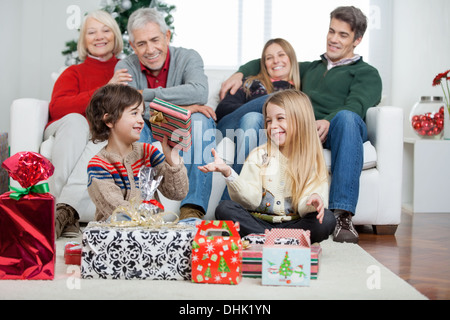 Family With Christmas Presents At Home - Stock Photo