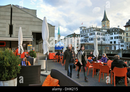 People at a street cafe in front of the town hall at Limmat river, Zurich, Switzerland, Europe - Stock Photo