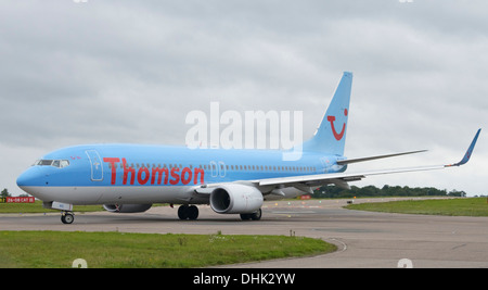 Thomson Boeing 737-800 taxiing to the terminal - Stock Photo