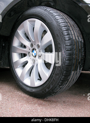 New tire on a BMW alloy wheel - Stock Photo