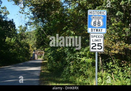 Route 66 road sign by an old truss girder box bridge crossing a river in rural Missouri, USA - Stock Photo