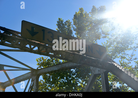 Height restriction sign on old truss girder box bridge crosses a river on old Route 66 in rural Missouri, USA - Stock Photo