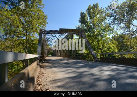 Old truss girder box bridge crosses a river on old Route 66 in rural Missouri, USA - Stock Photo