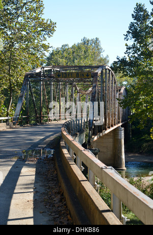 Old truss girder box bridge crosses a river on old Route 66 in rural Missouri, USA with 14' 9' height restriction - Stock Photo