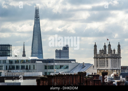 The Shard towers over the city of London - Stock Photo