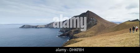 Three walkers on Achill island County Mayo Ireland - Stock Photo