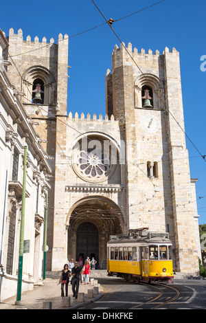 Electrico 28 tram passing in front of Se Catedral cathedral in Alfama district, Lisbon, Lisboa, Portugal - Stock Photo