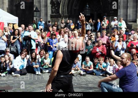 Street performer Mighty Gareth and a volunteer during the Edinburgh International Festival Fringe, Scotland, UK - Stock Photo