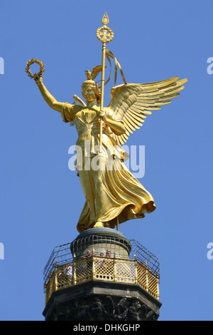 The Victory column (Siegessäule) in Berlin, Germany, with the statue of Victoria at the top. - Stock Photo