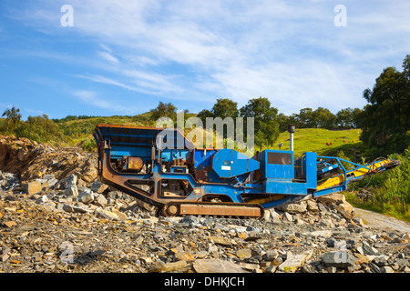 Stone crusher in the mountains at a quarry. - Stock Photo