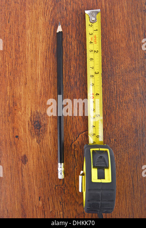 laminate and tape measure and pencil - Stock Photo