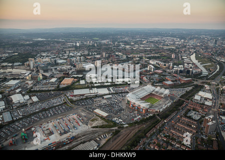 Twilight aerial view over Manchester with Old Trafford Football and Cricket Ground in the foreground. - Stock Photo
