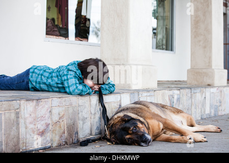 A 10 year old boy and his dog spending time together - Stock Photo