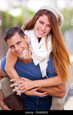 Young Couple laughing in the city - Stock Photo
