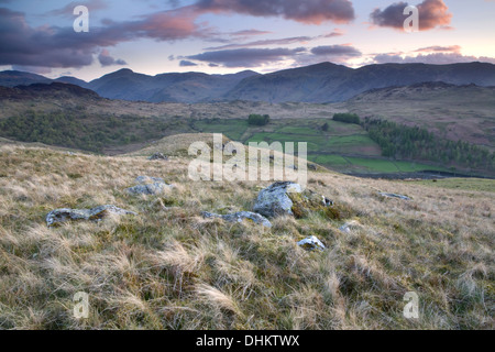 After the sun had set over Derwent Fells, pink clouds lit up the sky over Watendlath Fells, Cumbria, creating an - Stock Photo